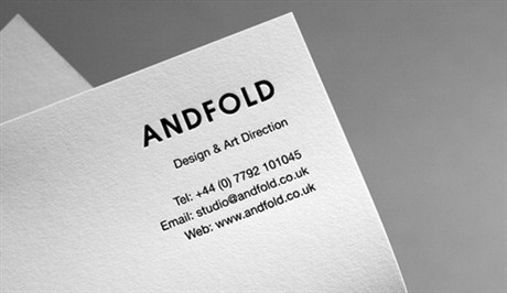 Embossed White business card